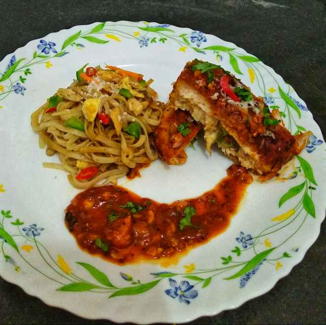 Photo of Stuffed chicken in red sauce with buttery spaghetti by Debjani Dutta at BetterButter