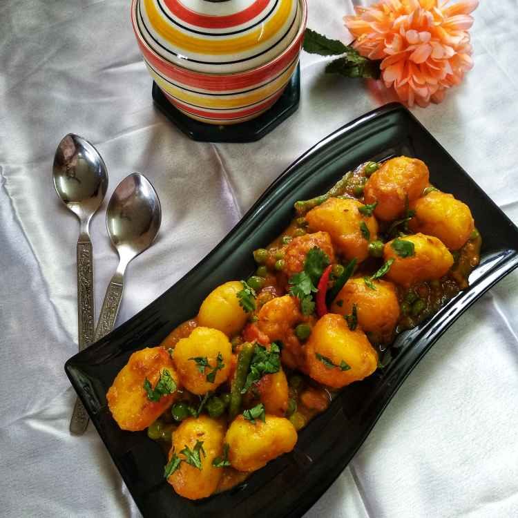 Photo of Dum aloo with green peas by Debjani Dutta at BetterButter
