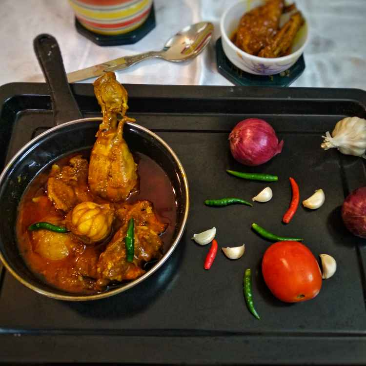 Photo of Chicken curry with whole garlic by Debjani Dutta at BetterButter