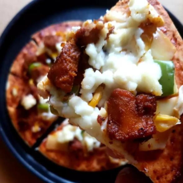 Photo of Chicken tikka pizzq by Safiya Khan at BetterButter