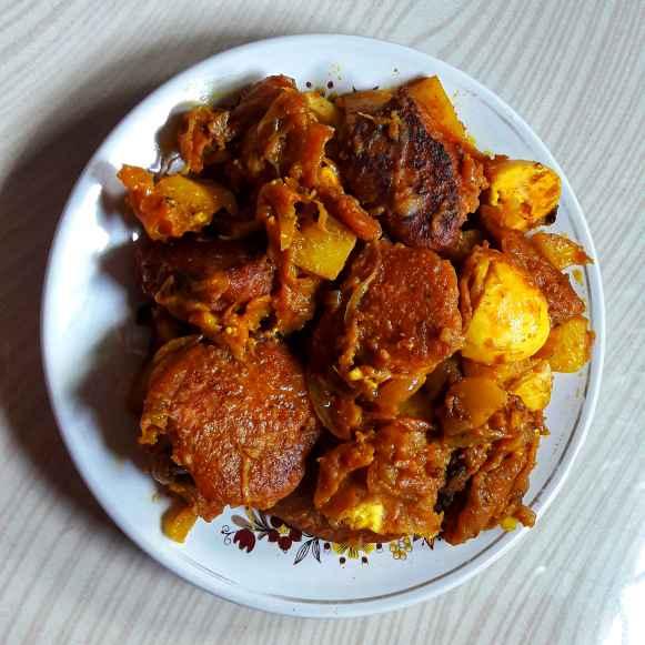 Photo of Egg pakoda curry by Ambitious Gopa Dutta at BetterButter