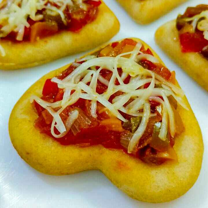 Photo of Minizzas ( Little Heart Pizzas ) by Anju Bhagnari at BetterButter