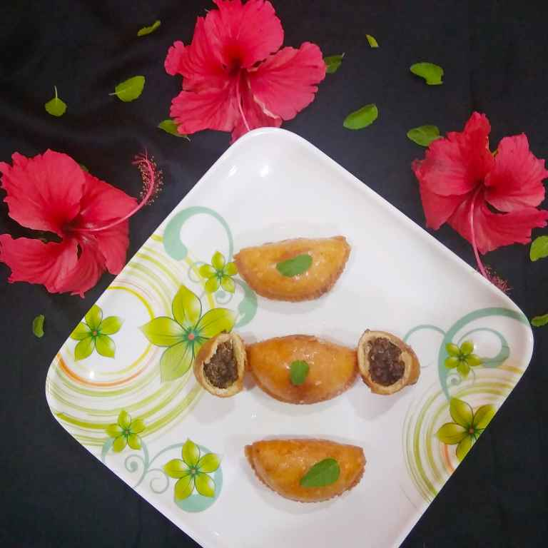 Photo of Dried Prunes and dessicated coconut stuffed sweet dumplings by Ankita Tahilramani at BetterButter