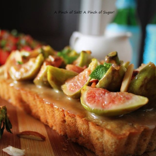 Photo of Spiced Fig, Coffee and Almond cake with Whiskey caramel glazed figs and fresh Strawberries. by Bency Koshy at BetterButter