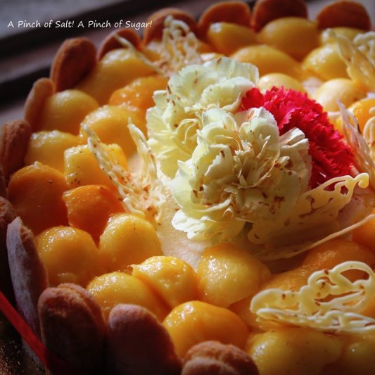 How to make Mascarpone Cream cheese Mango cake with a white rum custard and home made Italian lady fingers topped with fresh mangoes NO BAKE