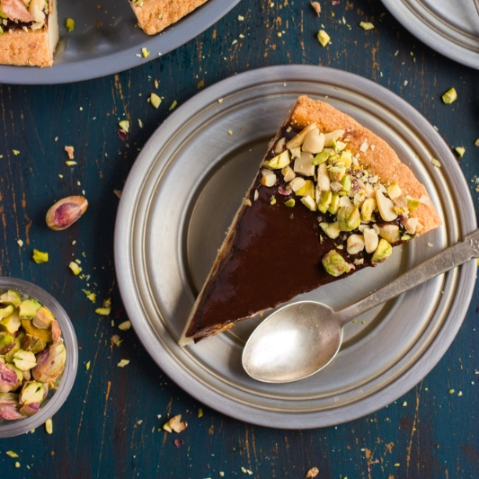Photo of Chocolate Caramel Tart with Pistachio Topping by BetterButter Editorial at BetterButter