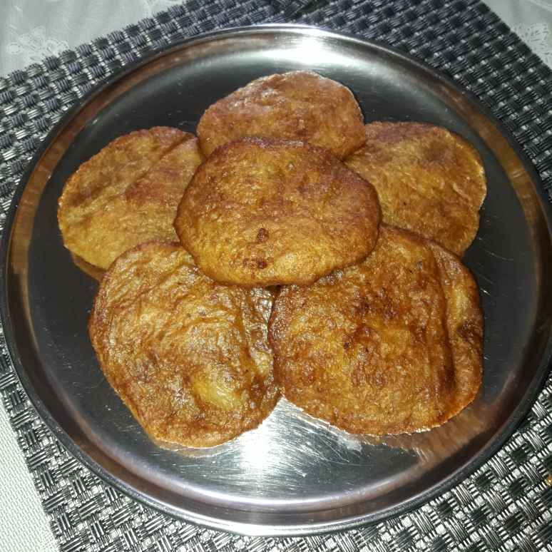 Photo of Coconut jaggery fritters by Chandrika Marripudi at BetterButter