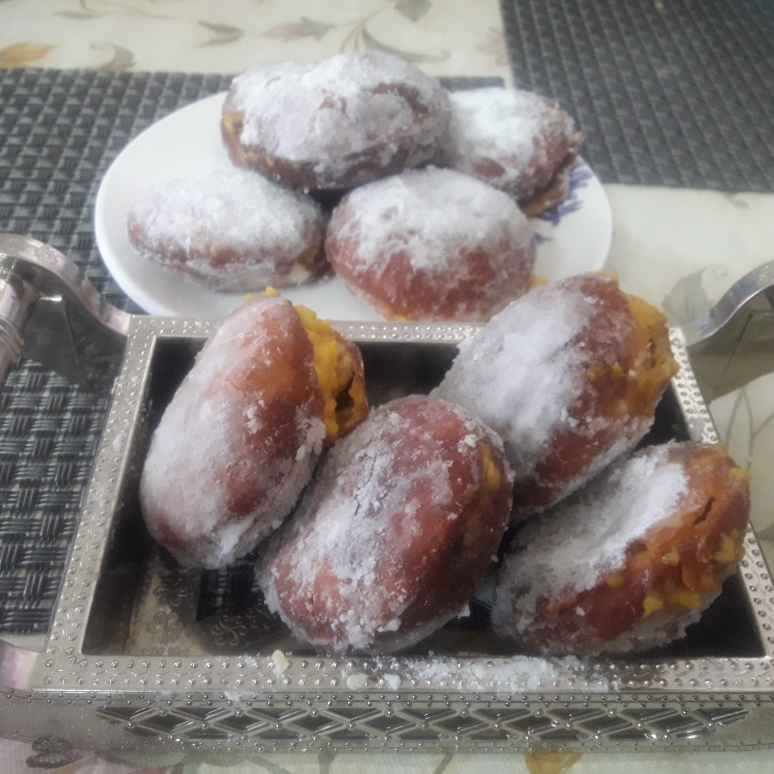 Photo of Donuts filled with custard nuts cream by Chandrika Marripudi at BetterButter