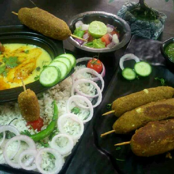 How to make Jeera rice with kadhi and kala chana kabab