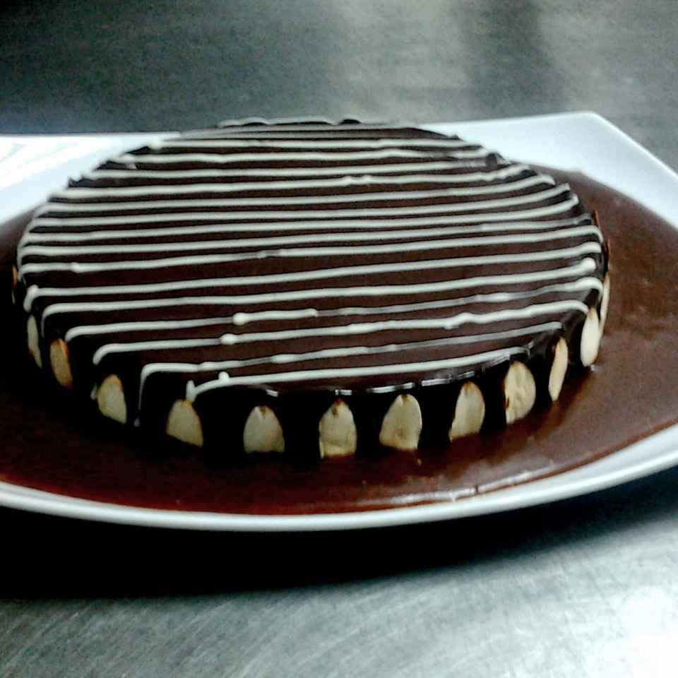 Photo of Badam ganach cake sobat chocolate sauce by Aarti Nijapkar at BetterButter