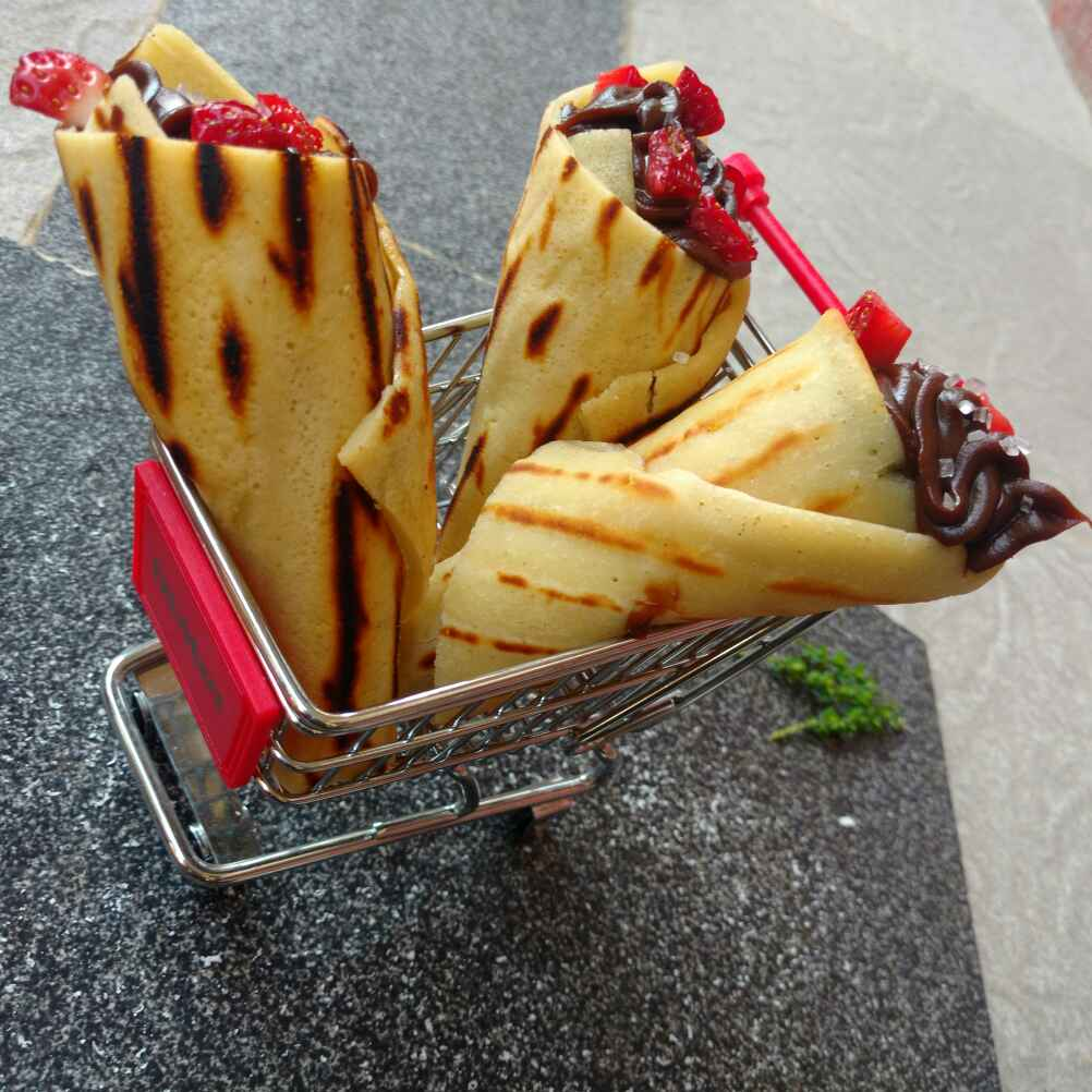 Photo of Waffels cone with nutella choco spread by ChefVenkatesh Sharma at BetterButter