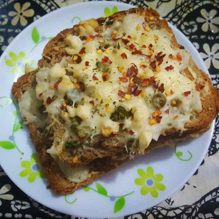 Photo of Multigrain bread cheese garlic toast by debashri chatterji at BetterButter