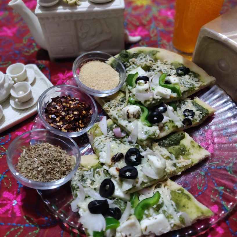 Photo of Thin crust Pizza in basil sauce by Disha Chavda at BetterButter