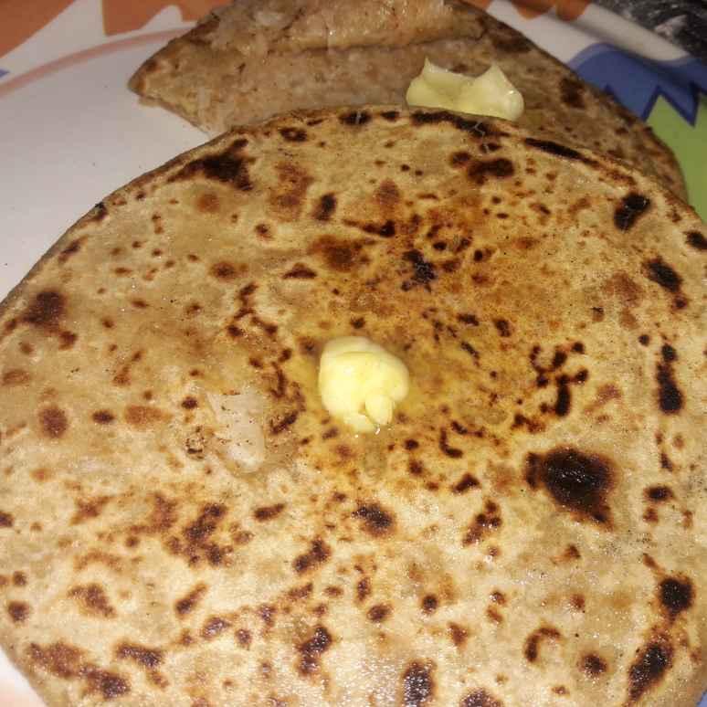 Photo of Stuffed mooli paratha with butter by Ekta Sharma at BetterButter