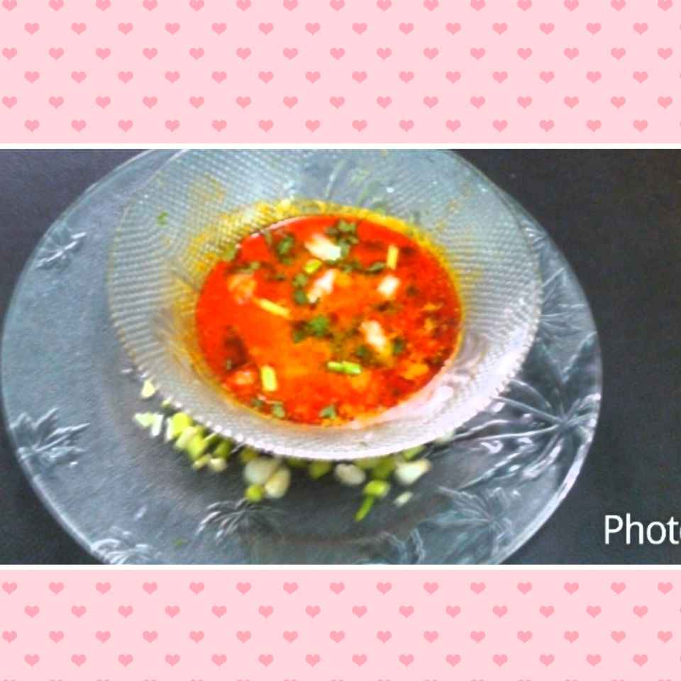 How to make Green garlic in tomato gravy.