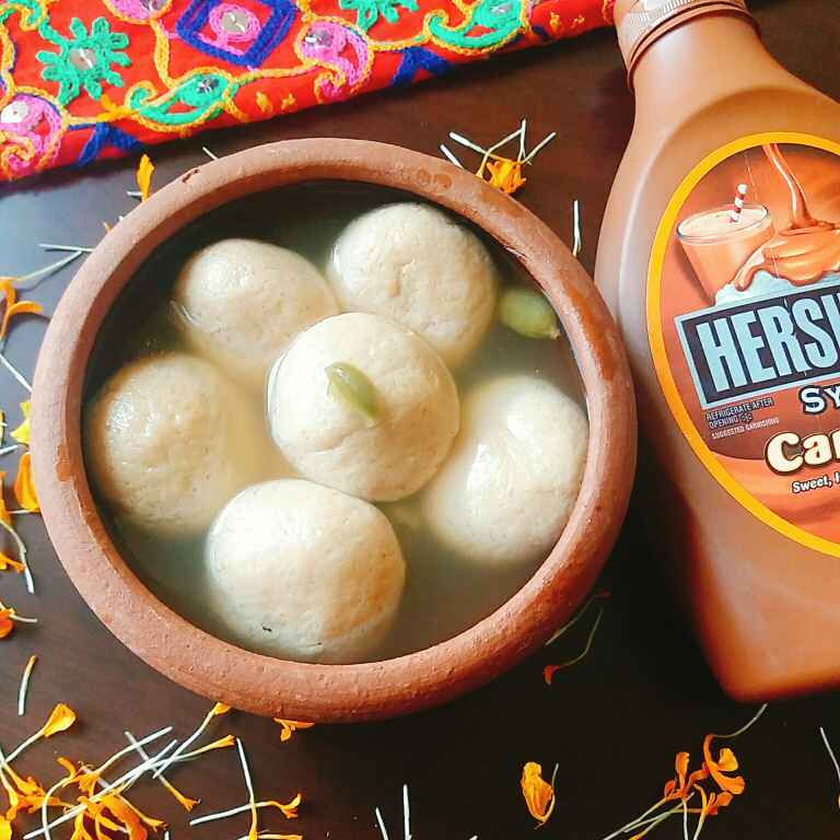 Photo of Caramel rasgulla with Hersheys caramel syrup. by Illa Kanungo at BetterButter