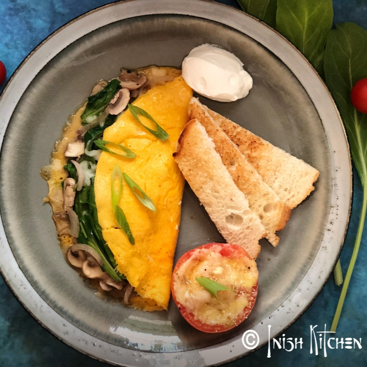 Photo of Stuffed Omelet with Cheesy Tomato by Inish Issac at BetterButter