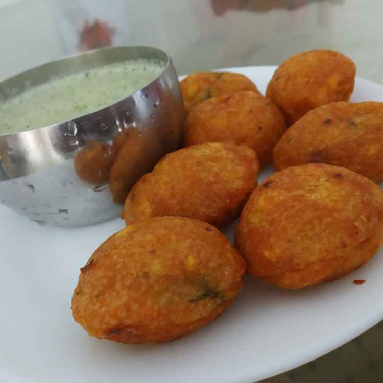 Photo of spicy paniyaram with coconut chutney by jassi aarif at BetterButter