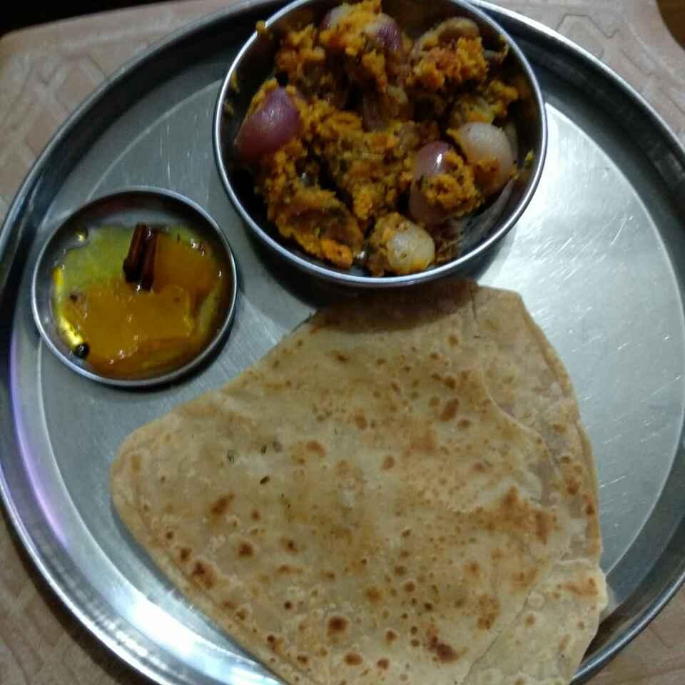 Photo of Stuffed onion subji and triangle . by Kavi Nidhida at BetterButter