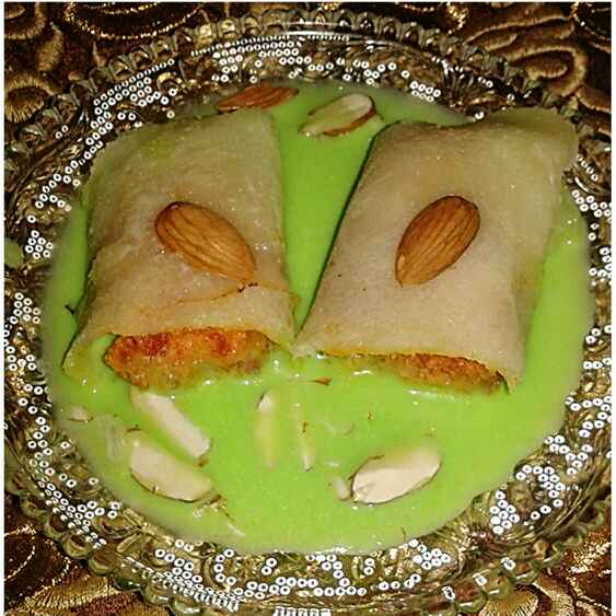 Photo of Carrot halwa pockets in pista rabdi by Kiran Kherajani at BetterButter