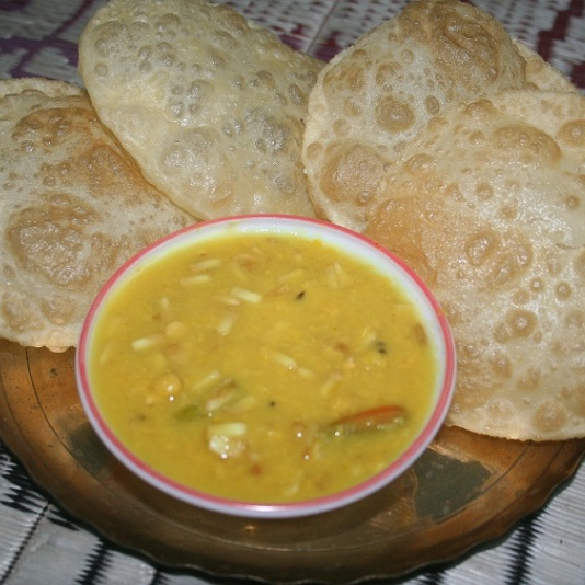 How to make Luchi and Narkel-Cholar Dal (Luchi and Chana Dal with Coconut)