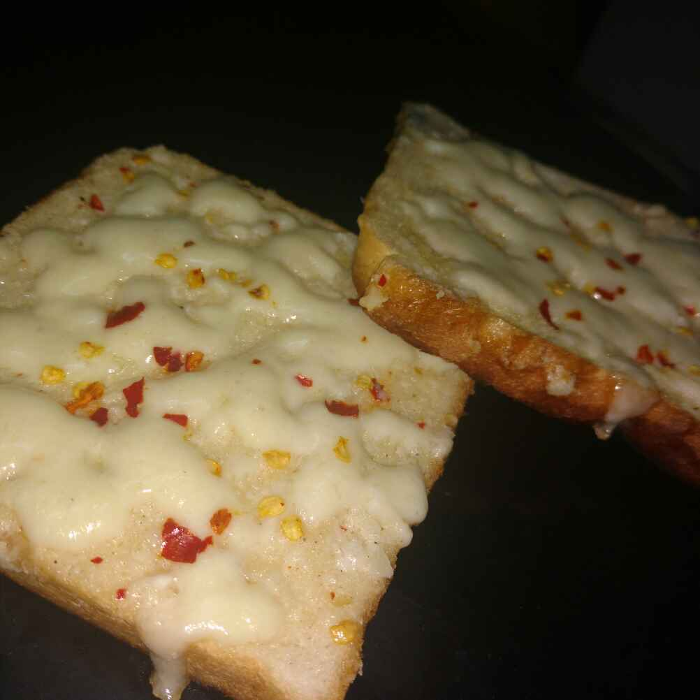 Photo of Cheesy garlic bread by KRITIKA SINGH at BetterButter