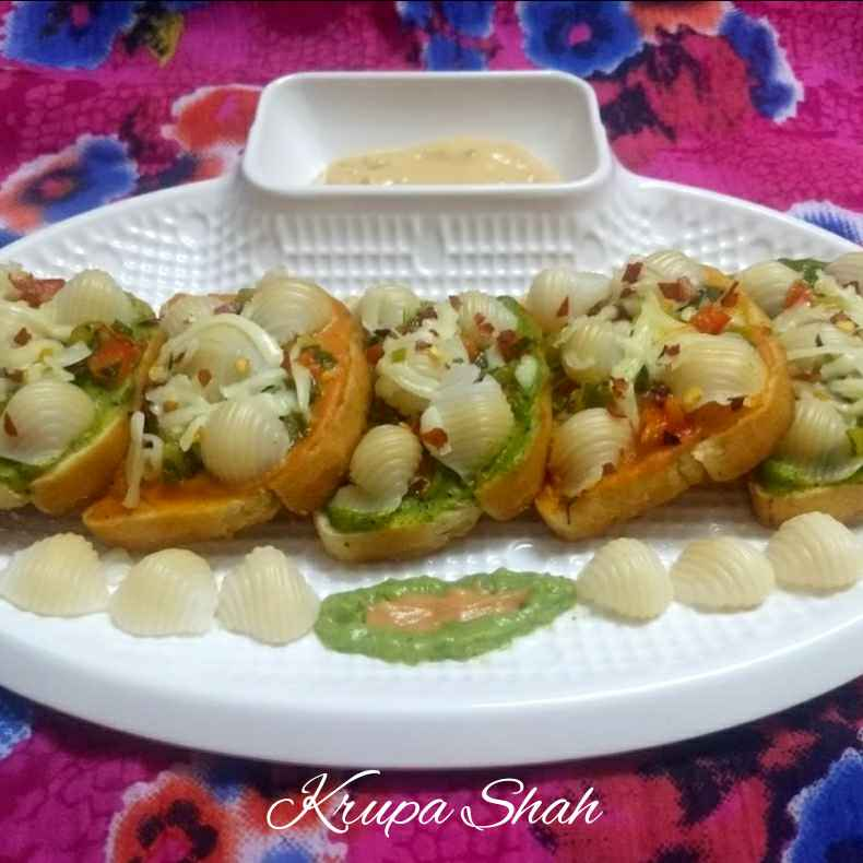 Photo of Colourful Garlic bread bruschetta topped with pasta by Krupa Shah at BetterButter