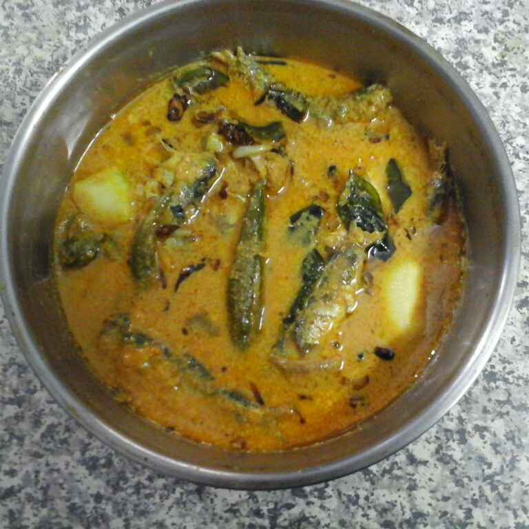 How to make Fish with mango in coconut milk gravy.