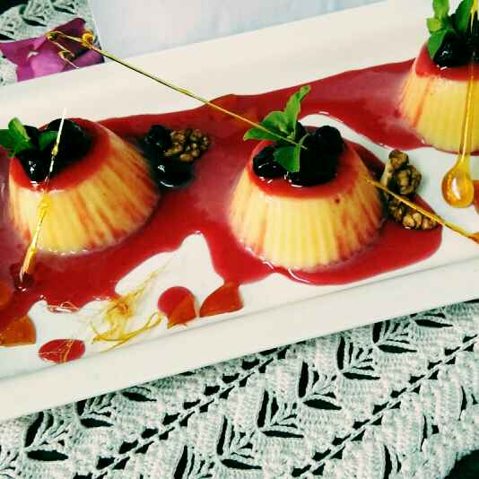 How to make Pineapple pannacotta with blackcurrant and strawberry reduction.
