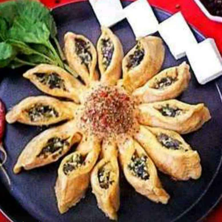Photo of Palak Paneer sunflower bread by Mahua Nath at BetterButter