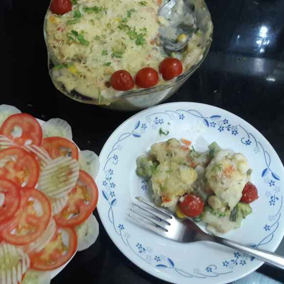 Photo of Cheesy baked vegetables in white sauce by Mamta Joshi at BetterButter