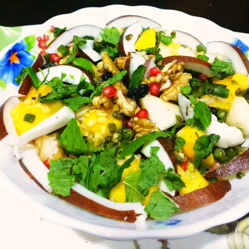 How to make Mango, moong Sprout, French beans, Walnut, dried Black current, Corn, Pomegranate, Pear , Corn and Freash Coconut  Salad Bowl.(  A downpour of healthy foods in monsoon.