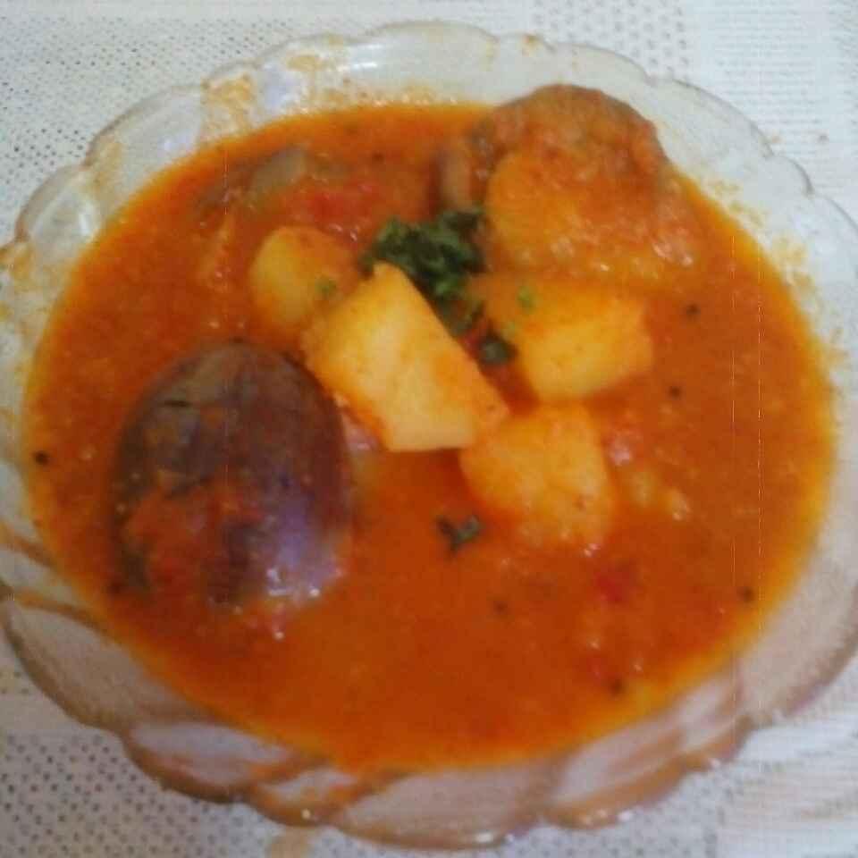 Photo of Potatoes, brinjal in tomato gravy by Maya Joshi at BetterButter