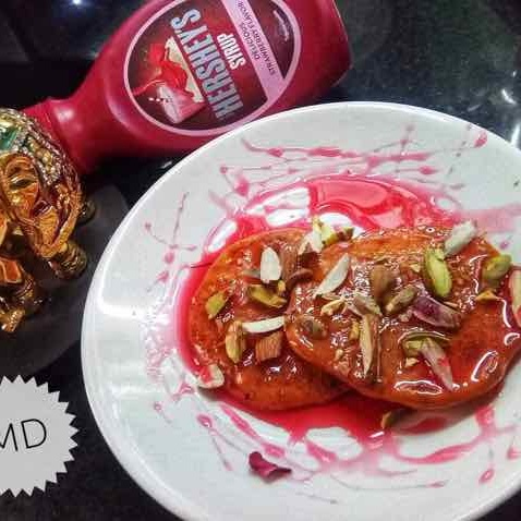 How to make Malpua with strawberry syrup