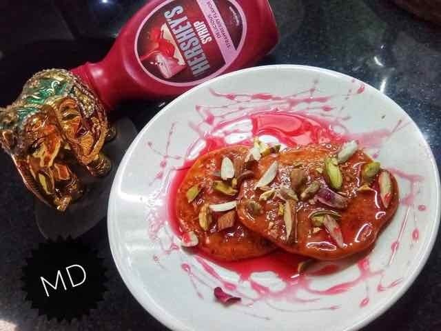 Photo of Malpua with strawberry syrup by Medha Devdas at BetterButter