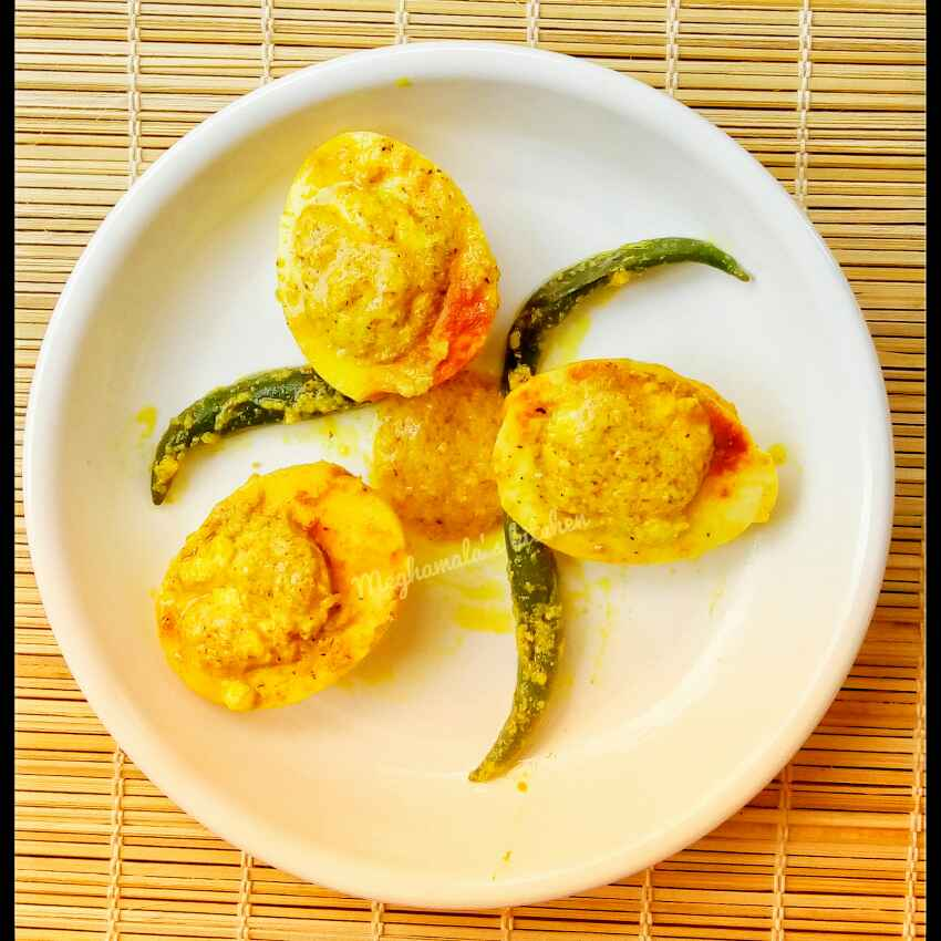 Photo of Dim Bhapa (Steamed egg in mustard paste) by Meghamala Sengupta at BetterButter