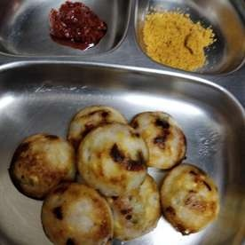 Photo of Paniyaaram with red onions, soaked moong dal, coriander by Naginic Chandramouli at BetterButter