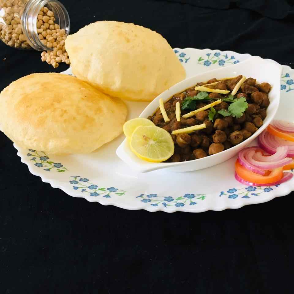 Photo of Amritsari choley with fluffy bhature by Naheed Alam at BetterButter