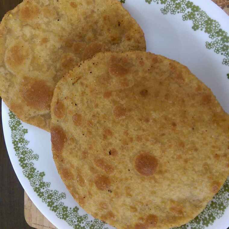Photo of Moong Dal Stuffed Poori by Nandini Mitra at BetterButter