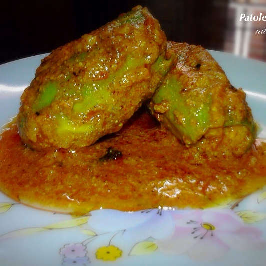 Photo of Niramish Patoler Dolma/Stuffed Pointed Gourd Curry by Nilanjana Bhattacharjee at BetterButter