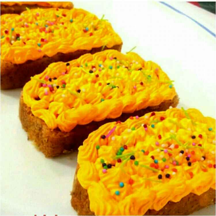 Photo of Banana cake slices froasting with yellow cream by Parul Jain at BetterButter