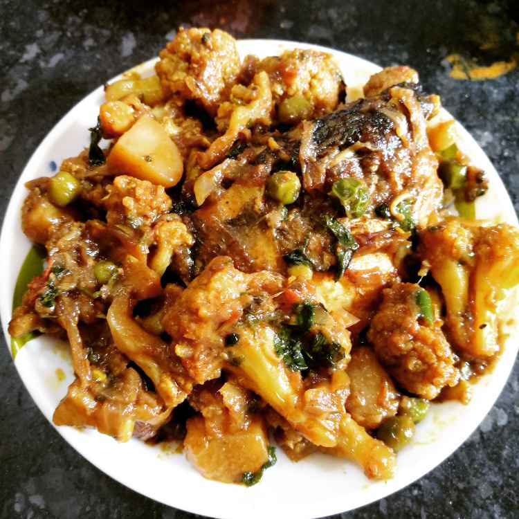 Photo of Cauliflower with fish head by Poulomi Halder at BetterButter