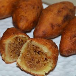 How to make Muger/Moong Daler Vaja Pithe (Fried Dumplings with Lentil Shells & Coconut Filling)