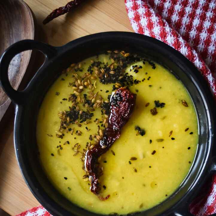 How to make Tok daal (tangy lentil with green mangoes)