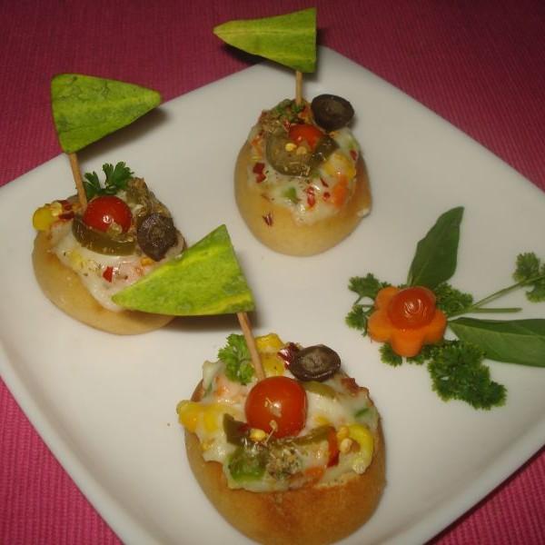 Photo of Home made stuffed baked mini  buns by suman prakash at BetterButter