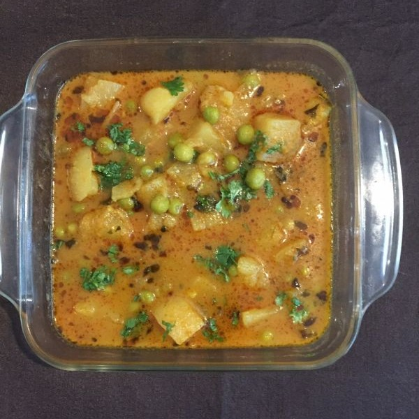 Photo of Aloo Matar Curry (potatoes and peas) by bina bedi at BetterButter