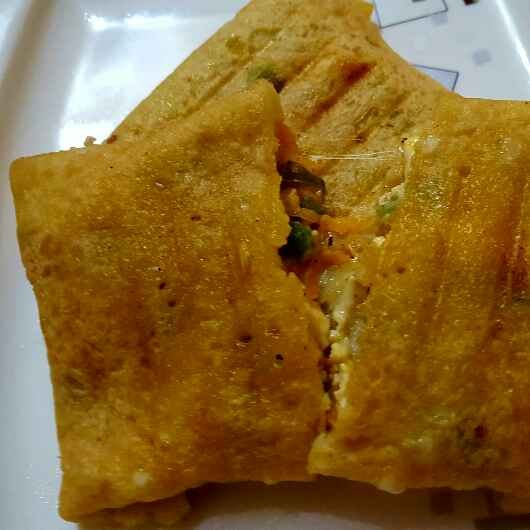Photo of Moong dal chilla grilled pockets filled with vegetables and cheese by Radhika Chhabra at BetterButter