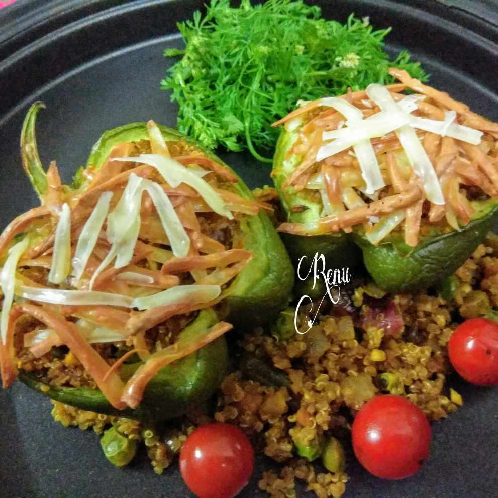 Photo of Quinoa stuffed baked cheesy capsicum by Renu Chandratre at BetterButter