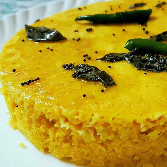 How to make Steamed cake prepared with chickpeas flour and spices.