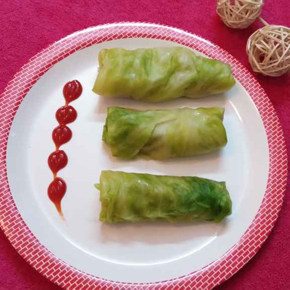 Photo of Steamed cabbage leaf roll stuffed with chicken by sampa sardar at BetterButter